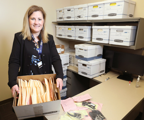 Karen Anne Pittman with some of the unclaimed property that patients have left behind at VUMC's hospitals and clinics.