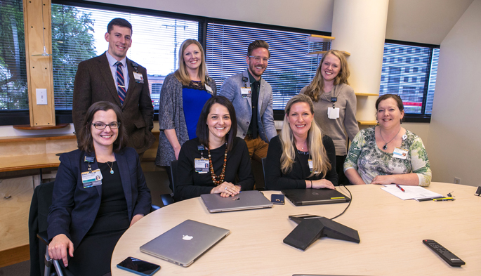 A Population Health Pharmacy Team at Vanderbilt Health is piloting a program that decreases medication errors after hospital discharge. Seated, from left are, Michelle Griffith, MD; Erin Neal, PharmD, MMHC; Jennifer Booker, LCSW; and Janet Campbell, RN, BSN. Standing, from left, are Gary Owen, PharmD, MPH; Megan Monroe, PharmD; Chris Terry, PharmD, CDE; and Cate Mart, LMSW.