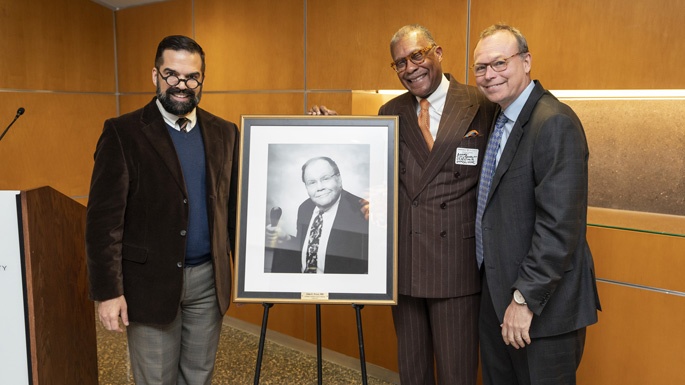 Del Ray Zimmerman, left, André Churchwell, MD, and Jeff Balser, MD, PhD, pose with the portrait of John Fryer, MD.