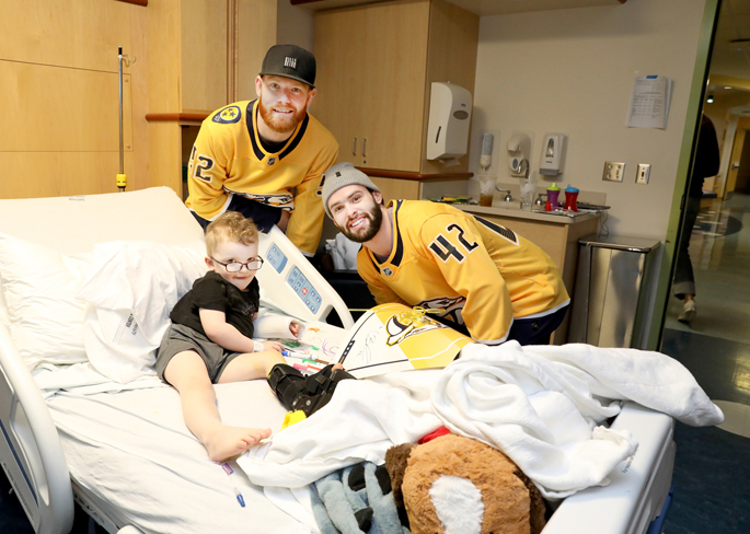 Predators defenseman Matt Irwin, left, and center Colin Blackwell, posed with Finnick Sheehan, 3, at Monroe Carell Jr. Children's Hospital at Vanderbilt Friday. Irwin and Blackwell were joined by teammates Ryan Johansen and Roman Josi during a recent visit to the hospital.
