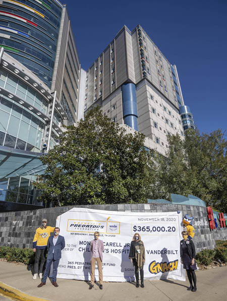 On hand for the presentation of the Predators' gift were, from left, goalie Pekka Rinne, Twice Daily's Eric Stokes, the Predators' Michelle Kennedy, and VUMC's Debra Friedman, MD, and Meg Rush, MD.