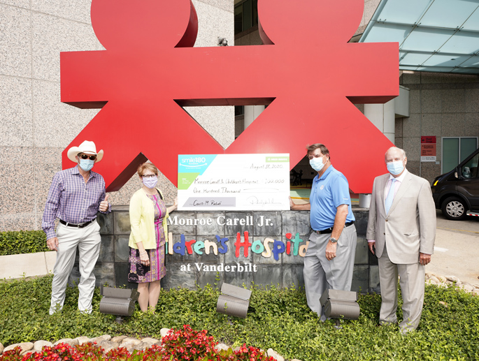 In the above photo, Delta Dental presents a check to Children's Hospital leadership. From left are Grammy Award-winning country music artist Kix Brooks, chair of the Children's Hospital Advisory Board, Meg Rush, MD, MMHC, President of Children's Hospital, Phil Wenk, president and CEO of Delta Dental and John W. Brock III, MD, Senior Vice President for Pediatric Surgical Services.