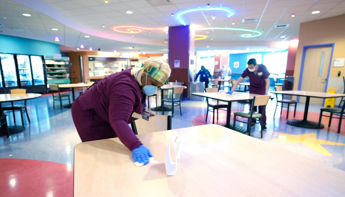 As part of International Housekeepers & Environmental Services Week, VUMC honored workers like Lakeshia Fletcher, shown here wiping down tables in the Café at Monroe Carell Jr. Children's Hospital at Vanderbilt, who have been on the front lines during the pandemic to keep facilities clean and safe.