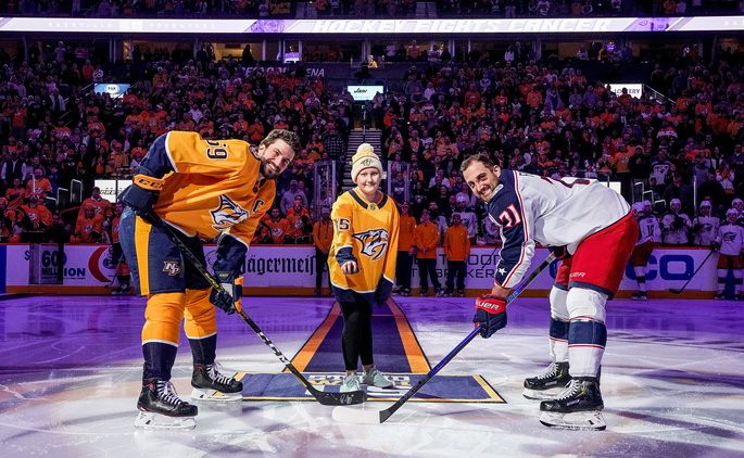 Monroe Carell Jr. Children's Hospital at Vanderbilt patient Maylee Wilshire served as Mayor of Smashville at the recent Nashville Predators Hockey Fights Cancer Night. Here, Wilshire drops the puck with Predators' captain Roman Josi, left, and Columbus Blue Jackets' captain Nick Foligno. Hockey Fights Cancer provides an opportunity to bring special guests from Children's Hospital to Bridgestone Arena and to let the young hockey fans have a one-of-a-kind experience with the Nashville Predators. All money raised during the games benefits the 365 Pediatric Cancer Fund at Children's Hospital to support childhood cancer initiatives.