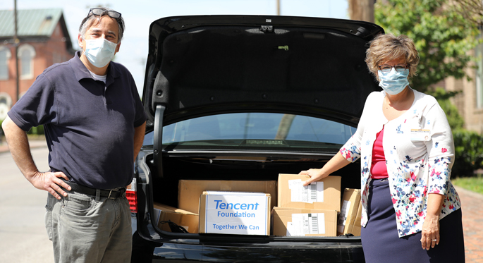 Metro vice mayor Jim Shulman and Dena McCormick, vice president of Vanderbilt Health Purchasing Collaborative, pose for a photo with boxes of masks being donated to Vanderbilt University Medical Center after packing the masks into a car at a temporary storage location on Monroe Street Monday, May 4, 2020 in Nashville, Tennessee. The Ferrell McDaniel Company donated thousands of masks to Vanderbilt University Medical Center.