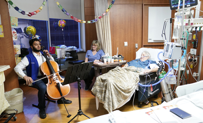 Blair School of Music junior Javin Bose, left, recently played cello for visitor Angela Pursley and her mother, ICU patient Linda Saddler. The live performance was part of the Therapeutic Music in the ICU pilot project, which studies the effect of live music on ICU patients, staff and families. Since the program began in January, volunteers have played more than 85 hours for patients. Vanderbilt musicians are still needed for the study. Details can be found at https://nursing.vanderbilt.edu/projects/musicicu/index.php.