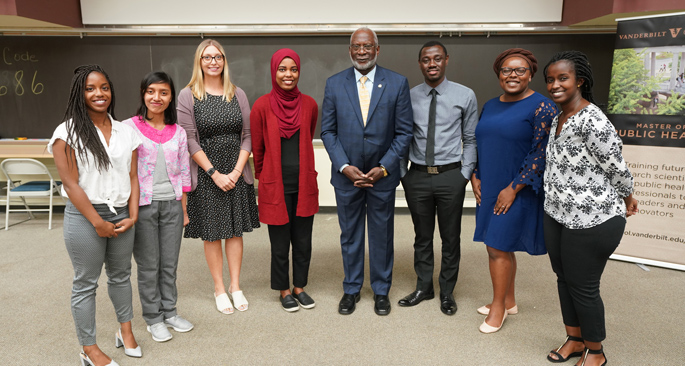 David Satcher, MD, PhD, center, stands with participants in the David Satcher Public Health Scholars Program. From left are Master of Public Health degree candidates Vicky Waithe, Ni Ketut Wilmayani, MD, Mina Nordness, MD, Muna Muday, Satcher Emmanuel Sackey, MBChB, Carleigh Frazier and Victoria Umutoni.