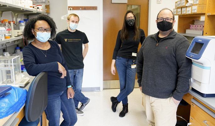 C. Henrique Serezani, PhD, right, and colleagues, from left, Amondrea Blackman, Nathan Klopfenstein and Júlia Miranda Ribeiro Bazzano are studying the early events of the inflammatory response to infection.