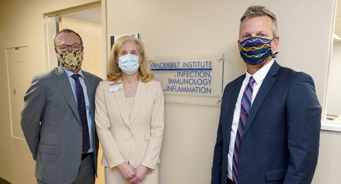 Jeff Balser, MD, PhD, left, Jennifer Pietenpol, PhD, and Eric Skaar, PhD, pose for a photo during a recent tour of new space for the Vanderbilt Institute for Infection, Immunology and Inflammation.