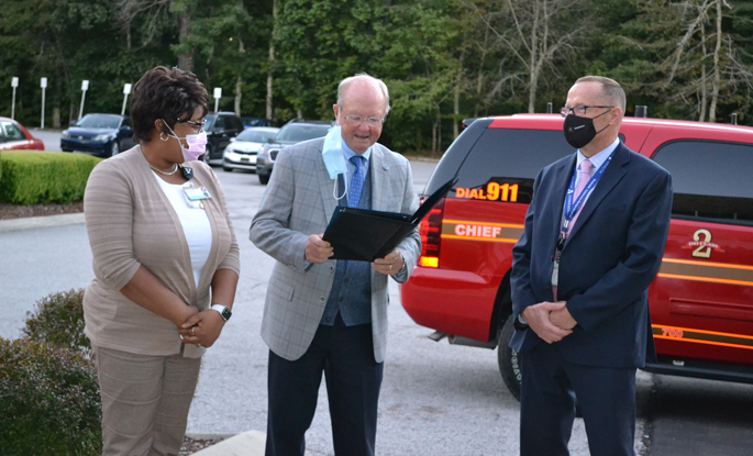 Tullahoma Mayor Ray Knowis reads the proclamation accompanied by VTHH's Rich Ellis and Marilyn Smith, DNP, MSN, RN.