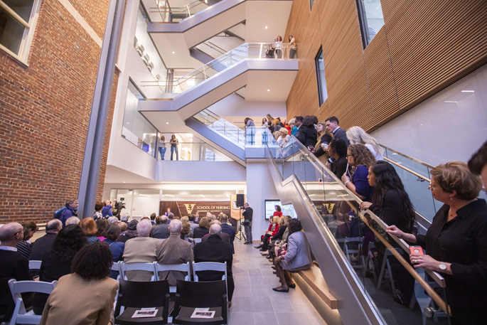Attendees at Tuesday's grand opening event learn more about the School of Nursing's state-of-the-art building expansion.