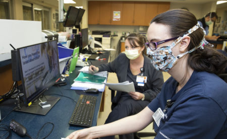 Stephanie Murphy, left, and Lori Fields, monitor systems in the ICU at Vanderbilt Wilson County Hospital during last week's transition to new IT systems. (photo by Susan Urmy)