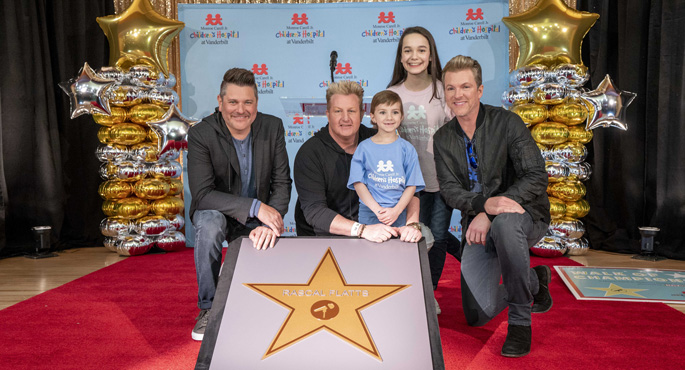 Award-winning vocal group Rascal Flatts, longtime supporters of Monroe Carell Jr. Children's Hospital at Vanderbilt, received a star on the hospital's Walk of Champions. Here, from left, the Rascal Flatts trio — Jay DeMarcus, Gary LeVox and Joe Don Rooney — pose alongside their new star with Children's Hospital patients Caroline Lantz and Jessica Meyer.