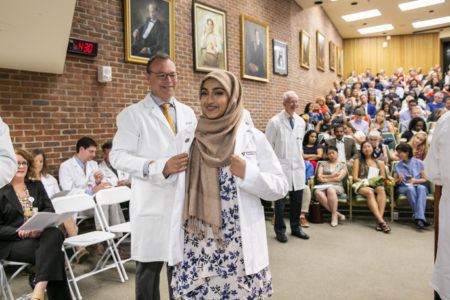 Bushra Rahman smiles after receiving her coat.