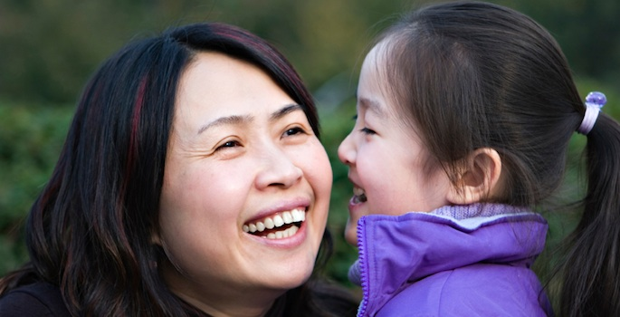 Asian woman and daughter laughing