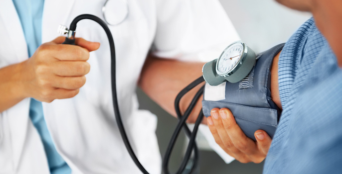 doctor checking patient's blood pressure