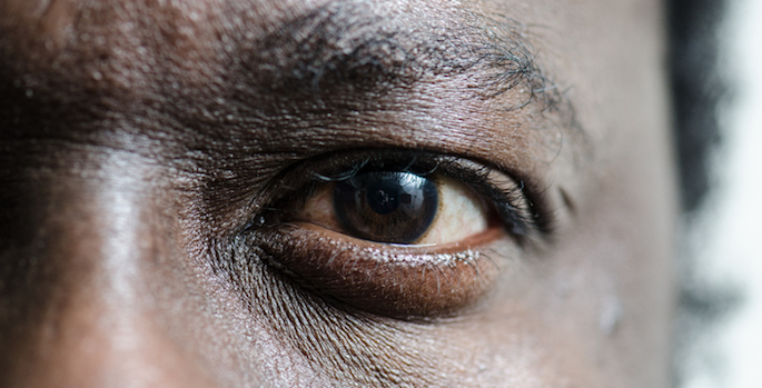 Close up on the left eye of a black man