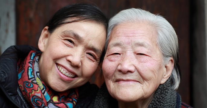 elderly Asian mother and adult daughter