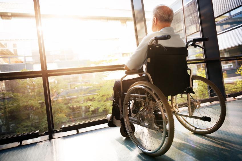 elderly man in wheelchair in skilled nursing facility